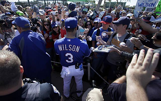 Super Bowl-winning quarterback Russell Wilson attended spring training with the Texas Rangers on Monday, March 3, and couldn't completely rule out a return to the baseball diamond -- a part of his life about which he admits he still dreams. Here are some photos from that session, along with a link on the last frame to the SI Wire story about his future plans.