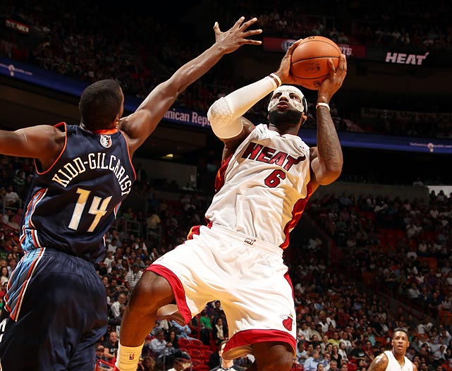 LeBron James of the Miami Heat looks to shoot as Michael Kidd-Gilchrist of the Charlotte Bobcats defends. James finished the game with a career-high 61 points, helping lead the Heat to a 124-107 victory.