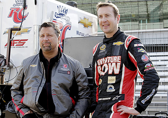 Kurt Busch completed an Indy 500 rookie program with team owner Michael Andretti (left) last year.