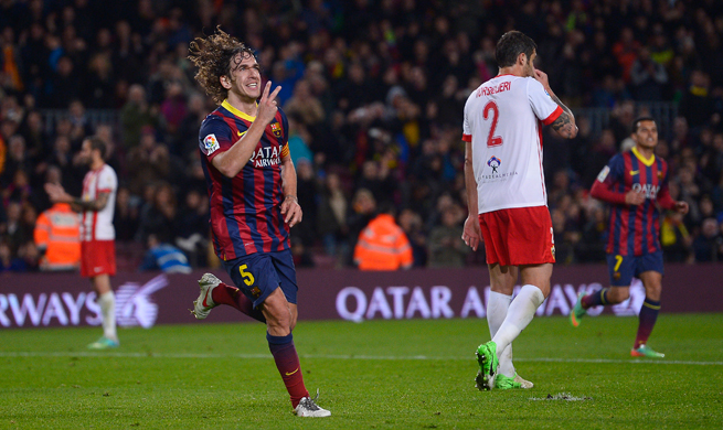 Barcelona captain Carles Puyol (5) says he is leaving the club at the end of the season.