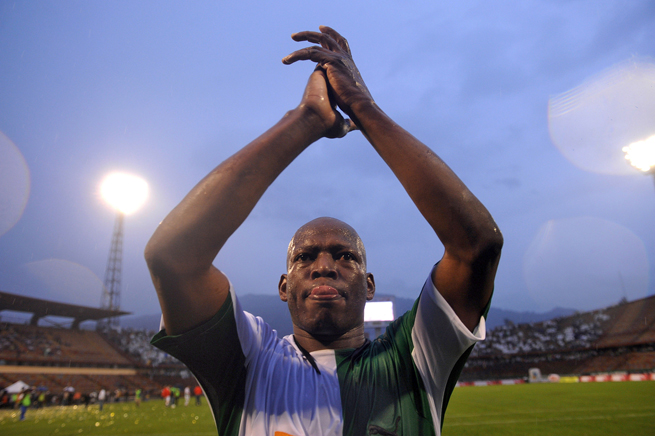 Faustino Asprilla applauds the fans following his farewell match.