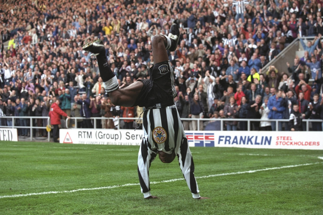 Faustino Asprilla goes into an extravagant goal celebration after scoring for Newcastle.