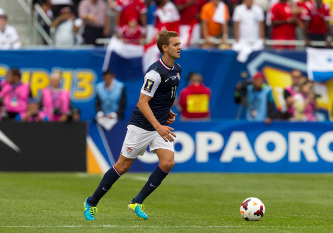 U.S. midfielder Stuart Holden is returning to the USA after hurting his knee in a match with Bolton's Under-21 side on Monday.