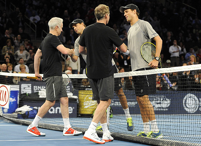 Bob and Mike Bryan won seven straight games before defeating John and Patrick McEnroe 8-3.