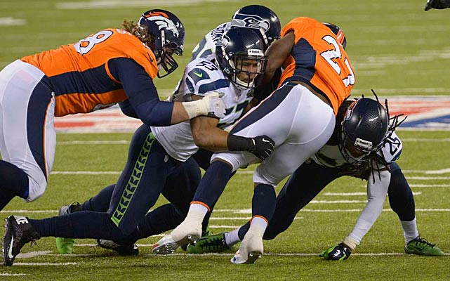 Seattle's do-everything secondary was a driving force in the Seahawks march to and victory in Super Bowl XLVIII. Led by Kam Chancellor, Earl Thomas and Richard Sherman (all pictured here tackling Knowshow Moreno), Seattle lowered the boom on Denver 43-8 in one of the most lopsided Super Bowls in history.