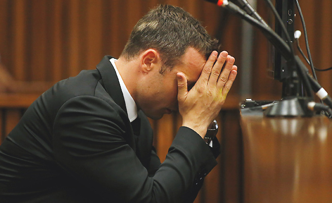 Testimony Wednesday focused on both Oscar Pistorius' murder charge and his unrelated gun charge.