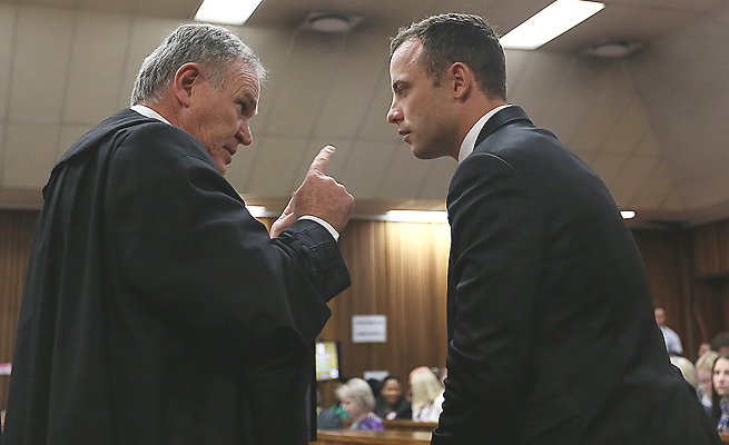 Attorney Barry Roux (left) is defending Oscar Pistorius in his murder charge and other gun charges.