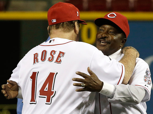 Rose hugs former teammate, Hall of Fame second baseman Joe Morgan, as their team is honored in Cincinnati. PETE ROSE: An American Dilemma Book by SI's Kostya Kennedy