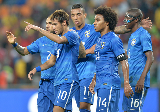 Neymar (10) celebrates after one of his three goals against South Africa on Wednesday.