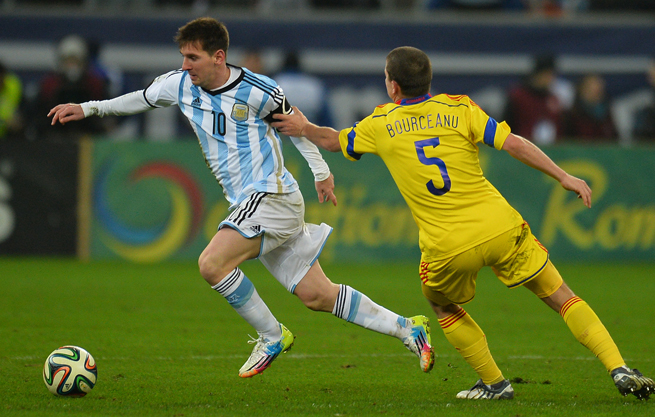Argentina star Lionel Messi tries to go by Romania's Ciprian Bourceanu during Wednesday's 0-0 draw.