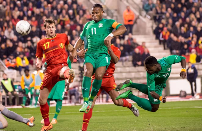 Didier Drogba (center) scored late to put Belgium under pressure for an eventual equalizer.