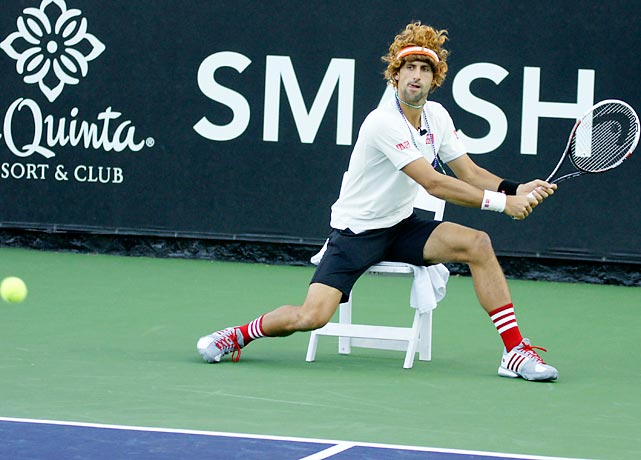 After a line judge sentenced him to the chair, the Serbian tennis whiz got wiggy with it during the 10th Anniversary Desert Smash at the fabulous La Quinta Resort and Club, which, in a stunning coincidence, just happens to be in La Quinta, California. You can't make this stuff up, though we try.