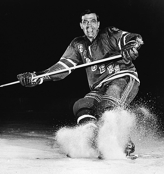 Itching to return to the ice, the legendary winger was 35 when the Rangers signed him in June 1966 after he'd spent two years coaching the Canadiens' farm team in Quebec City. A former two-time NHL scoring champion and league MVP, Boom Boom (so nicknamed for his hard shot and fiery personality) had skated with Montreal for 14 years and won six Stanley Cups. Fans in New York loved him during his two seasons as Ranger, though his best output (17 goals, 42 points) was a far cry from his prime years, but he helped the Rangers return to the playoffs where they swept by his old team in the first round in '67 and eliminated by Chicago in '68. After hanging up his skates, Geoffrion coached the team for half of the 1968-69 campaign. <bold>Notable Rangers during Geoffion's tenure:</bold> Rod Gilbert, Ed Giacomin, John Ratelle