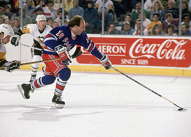 "The legendary ""Flower,"" one the greatest and most colorful wingers of all time, came out of a three-year retirement for an NHL encore on Broadway in Sept. 1988 at the ripe old age of 37, thus becoming the first active Hall of Famer since Gordie Howe. A five-time Cup winner, three-time scoring champion, two-time league MVP, and 1977 playoff MVP during his 14 years with Montreal, Lafleur had enough left to put up 18 goals and 45 points in 67 games while helping the Rangers return to the playoffs after a one-year absence. New York was swept by Pittsburgh in the first round and Lafleur signed on with the Quebec Nordiques that summer, concluding his illustrious career with them in 1991. <bold>Notable Rangers during Lafleur's tenure:</bold> Marcel Dionne, Brian Leetch, John Vanbiesbrouck"