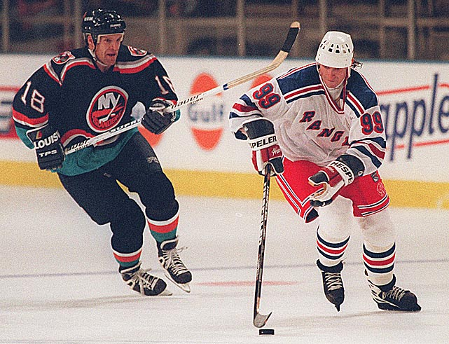It always seemed like it was only a matter of time before the Rangers landed The Great One. But when he finally arrived as a free agent in July 1996, he was 35 and no longer a prolific goal scorer. Reunited with old buddy Mark Messier and still in possession of his wizardly playmaking skills, Gretzky put up 97 points as the Blueshirts reached the conference finals where any thoughts of hoisting another Cup together evaporated in a five-game loss to the Flyers. Gretzky ended up retiring in 1999 after the Rangers failed to qualify for the playoffs during the final two seasons of his NHL career. <bold>Notable Rangers during Gretzky's tenure: </bold>Adam Graves, Brian Leetch, Mark Messier, Luc Robitaille, Mike Richter, Esa Tikkanen, Pat LaFontaine