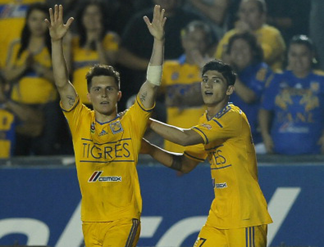 U.S. international and Tigres midfielder Jose Torres, left, celebrates after his goal against Cruz Azul in Saturday's victory.