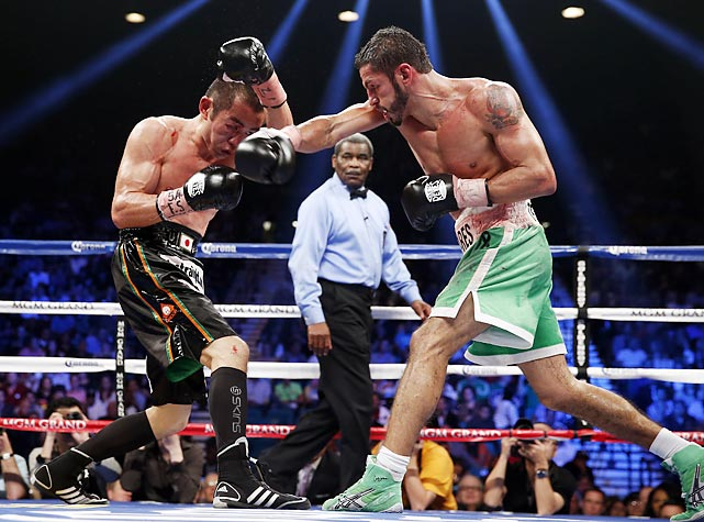 Jorge Linares of Venezuela strikes Nihito Arakawa of Japan during a lightweight bout on Saturday in Las Vegas. Linares won by unanimous decision.