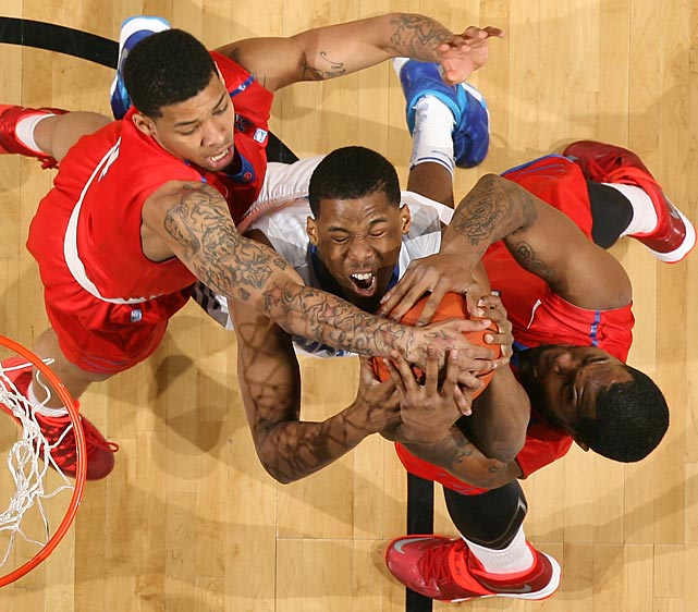 Nick King of the Memphis Tigers fights for a rebound as two SMU players try to take the ball in a Saturday game in Memphis. King's Tigers prevailed 67-58.