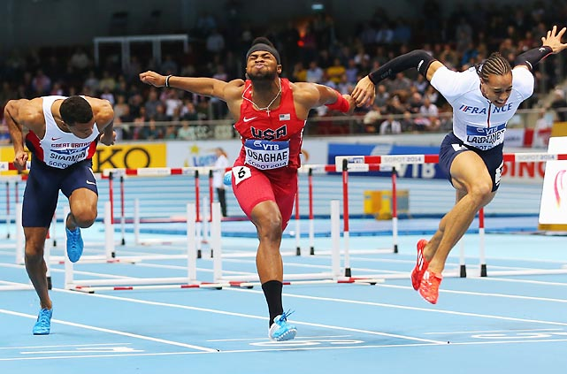 Omo Osaghae stretches to claim the gold medal in the 60-meter huddles final during the IAAF World Indoor Championships in Poland. Pascal Martinot-Lagarde of France (right) earned silver.