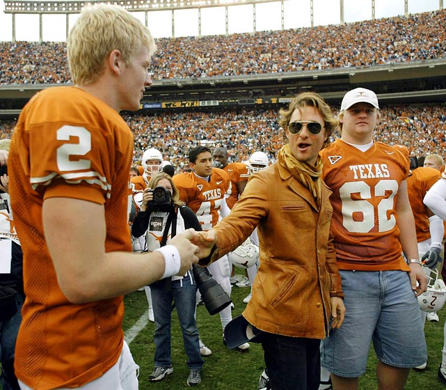 Matthew McConaughey shakes hands with Texas quarterback Chris Simms after the Longhorns defeatied the Texas A&M Aggies 50-20 on Nov. 29, 2002 at Memorial Stadium in Austin, Texas.