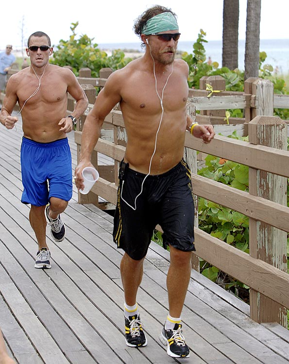 Lance Armstrong and Matthew McConaughey jog along South Beach on Aug. 23, 2006 in Miami.