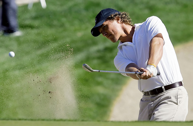 Matthew McConaughey hits from the bunker to the 12th green during the third round of the Bob Hope Classic golf tournament in La Quinta, Calif. on Jan. 20, 2006.