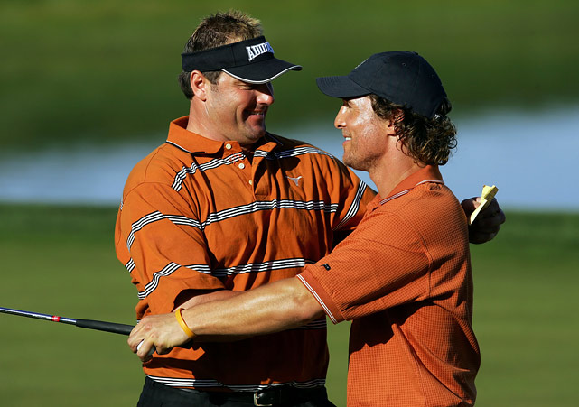Roger Clemens and Matthew McConaughey, wearing the orange colors of the University of Texas, embrace at the end of their round at the Bob Hope Classic golf tournament in Palm Desert, Calif., on Jan. 21, 2006.