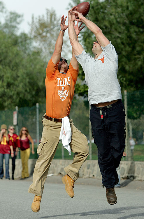 Matthew McConaughey stretches to catch a football against a fellow Texas fan in the parking lot before the Longhorns' National Championship game against USC at the Rose Bowl in Pasadena, Calif., on Jan. 4, 2006.