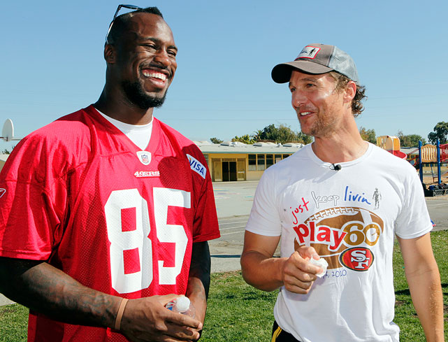 Matthew McConaughey and San Francisco 49ers tight end Vernon Davis share a laugh as they watch football drills at the 49ers Academy School in East Palo Alto, Calf., on Sept. 28, 2010.
