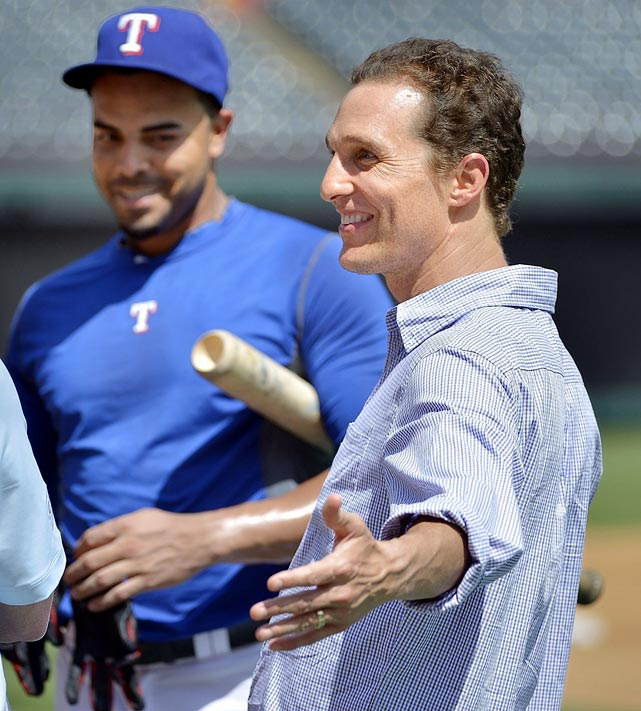 Matthew McConaughey smiles while talking with Texas Rangers right fielder Nelson Cruz before the Rangers game against the Cincinnati Reds at Rangers Ballpark in Arlington, Texas, on June 29, 2013. Just Keep Livin: Matthew McConaughey on Sports, Charity and Life