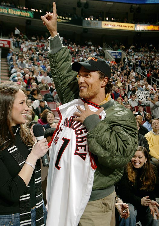 Matthew McConaughey salutes the crowd after being presented with a customized Philadelphia 76ers jersey during their game against the New Jersey Nets on March 2, 2005 at the Wachovia Center in Philadelphia.