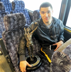 Fred VanVleet holds the MVC Player of the Year award trophy en route to the Indiana State game.