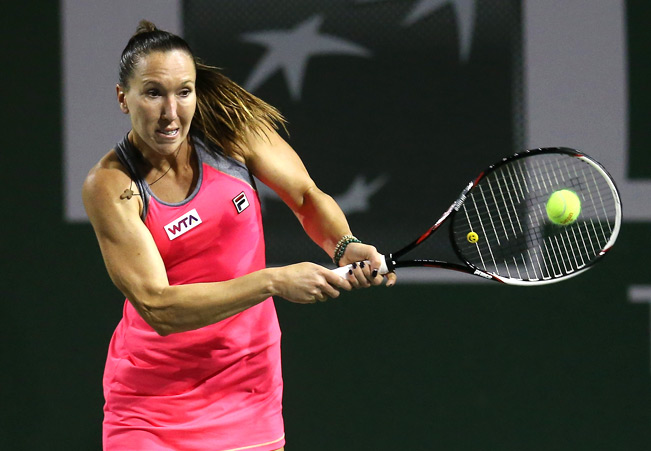 Jelena Jankovic breezed through her fourth-round match to beat Caroline Wozniacki 6-3, 6-1.