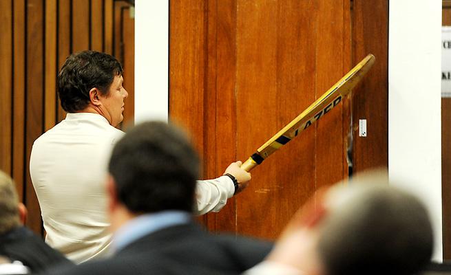 A forensic analyst re-enacted how he believes Oscar Pistorius broke down his bathroom door.