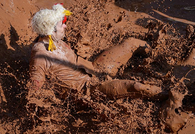 Competing in an extreme 28k run loaded with mud pits and other challenging obstacles requires sophisticated headgear and a great deal of intestinal fortitude of the kind seen here in Muennerstadt, Germany.