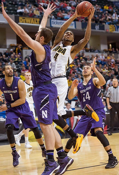 Leading Scorer: Roy Devyn Marble (17.3 ppg., pictured) Leading Rebounder: Aaron White (6.7 rpg.) Leading Passer: Mike Gesell (3.9 apg.) Bad Losses: Indiana, Northwestern Good Wins: Xavier, Ohio State, Nebraska, Michigan