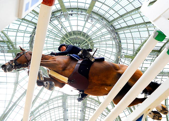 German rider Angelina Herroder and her horse ABC Trixi complete a jump during the Les Talentes Hermes on the second day of the Grand Prix Hermes of Paris.
