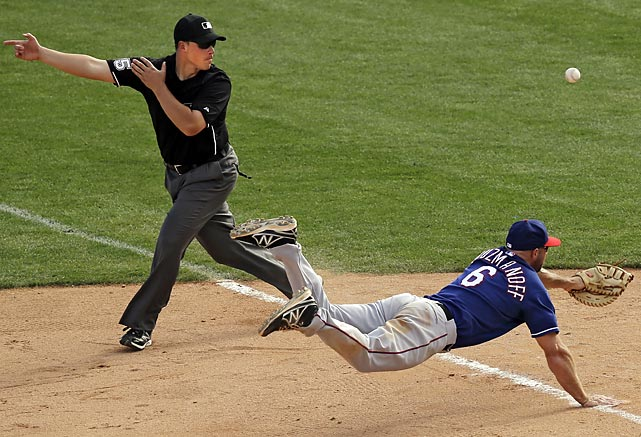 Texas Rangers first baseman Kevin Kozmanoff dives in vain at a single by Alex Liddi of the Chicago White Sox. The hit drove in the winning run in the ninth inning, giving Chicago a 7-6 victory.