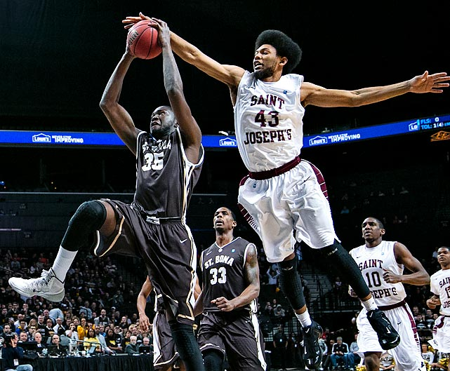 DeAndre Bembry of Saint Joseph's attempts to block the shot of St. Bonaventure's Youssou Ndoye during an Atlantic 10 Conference Tournament game on Saturday. Saint Joseph's earned a 67-48 victory.