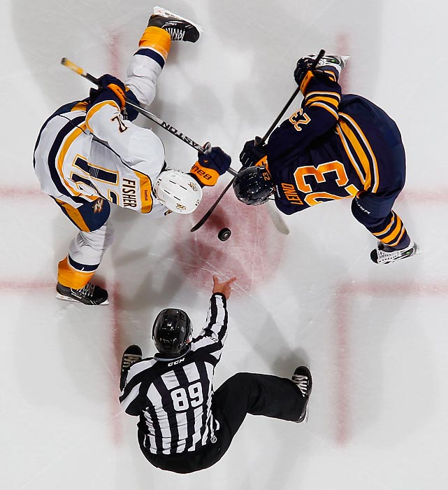 Buffalo Sabres center Ville Leino and Nashville Predators center Mike Fisher jostle for the face-off during the Predators' 4-1 victory.