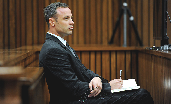 Oscar Pistorius' lawyer alleged photos showing moved evidence indicate police misconduct occurred.