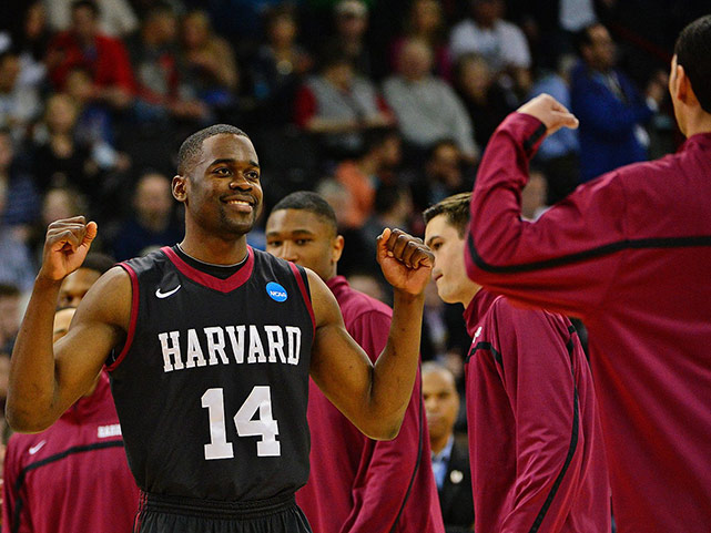 Steve Moundou-Missi and teammates celebrate only the second tournament victory in Harvard history. The Crimson knocked off New Mexico a year ago.