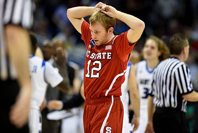 Tyler Lewis tries to make sense of North Carolina State's overtime loss to St. Louis, a five seed.