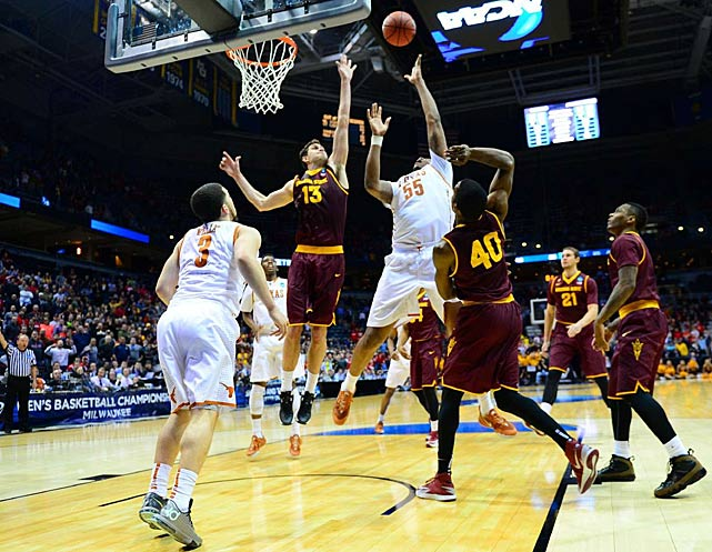 Cameron Ridley of Texas got this shot over the outstretched arm of Jordan Bachynski at the buzzer to advance the Longhorns to the next round.