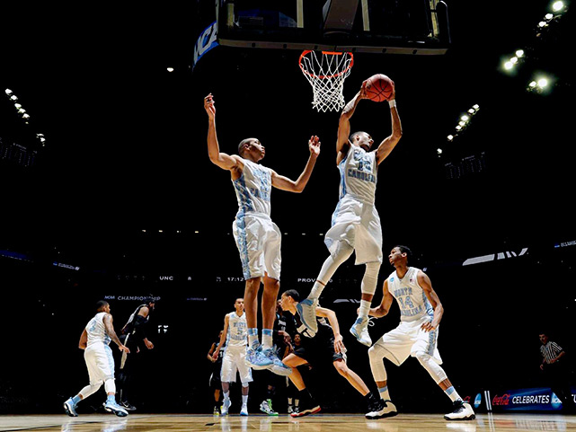 J.P. Tokoto (13) and Brice Johnson helped Carolina control the backboards (35-24).