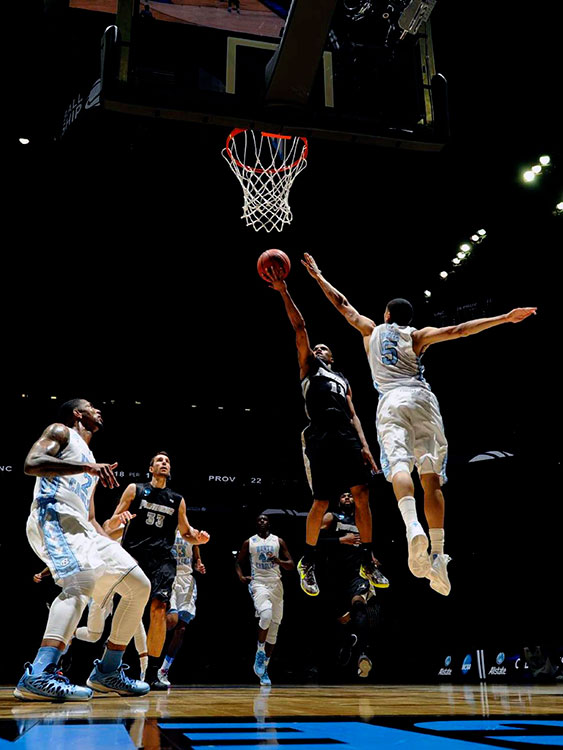 Bryce Cotton puts up a finger roll shot on a night when Providence came close to handing North Carolina its first tournament opener loss since 1999.