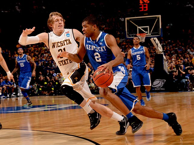 Aaron Harrison and Kansas handed Ron Baker and Wichita State their first loss of the season. Harrison scored 19 points while Baker finished with 20.