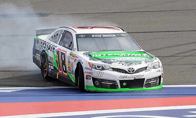 Kyle Busch survived a wild afternoon to win at Fontana in a race that featured 35 lead changes.