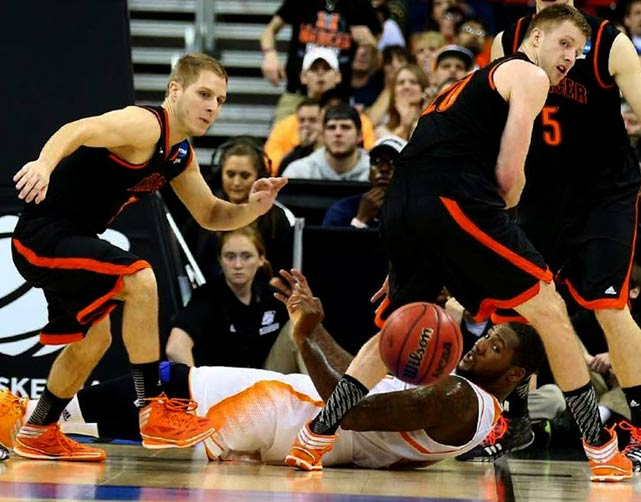 Kevin Canevari (far left) and Jakob Gollon get ready to give chase to a loose ball. The 11th-seeded Vols outrebounded Mercer 41-19 and kept the SEC perfect in the tournament.