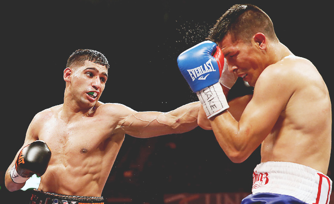 Amir Khan (left) has not fought since beating Julio Diaz by unanimous decision in April.